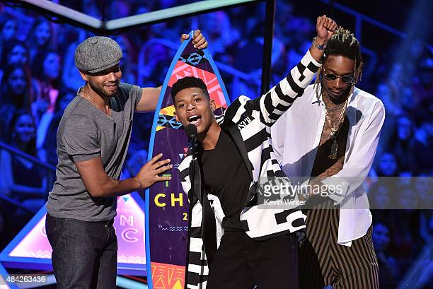 Actors Jussie Smollett and Bryshere Yazz Gray accept the Choice TV Award for Breakout Show for Empire from rapper Wiz Khalifa onstage during the Teen...