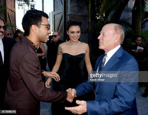 Actors Justice Smith Daniella Pineda and producer Frank Marshall arrive at the premiere of Universal Pictures and Amblin Entertainment's Jurassic...