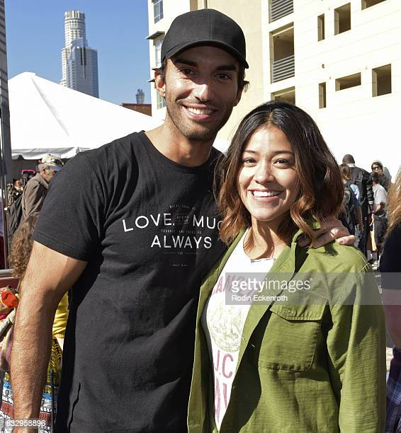 Actors Justin Baldoni and Gina Rodriguez pose for portrait at 3rd Annual Skid Row Carnival of Love on January 28 2017 in Los Angeles California