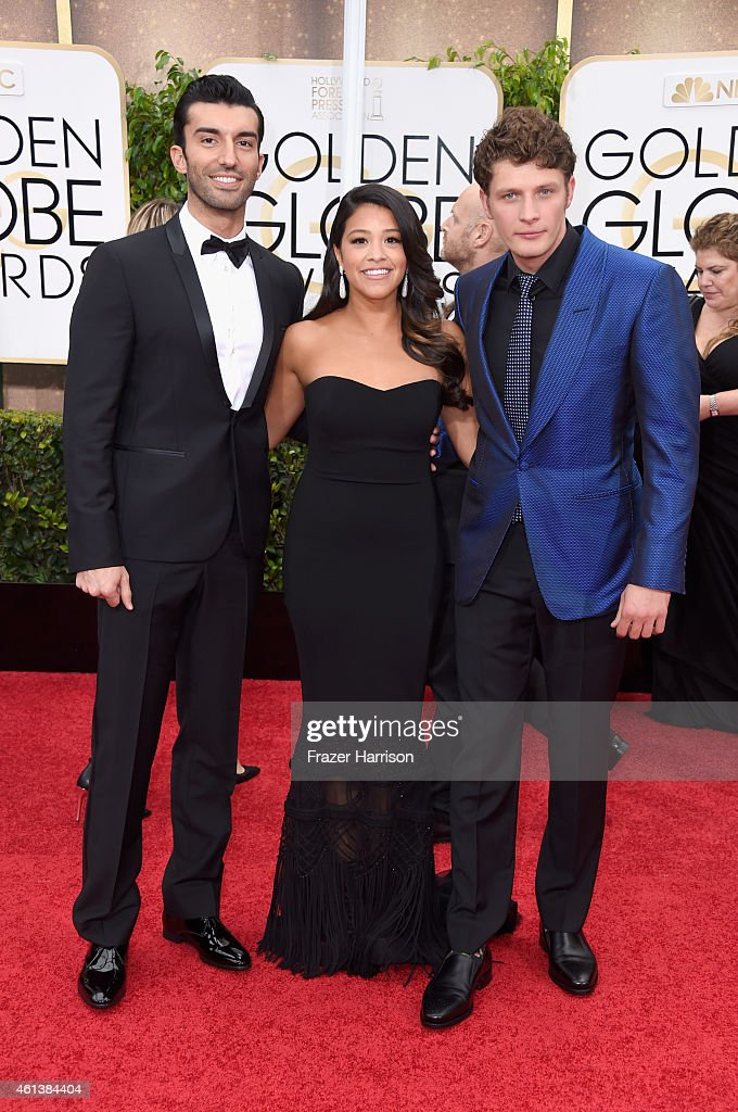 Actors Justin Baldoni, Gina Rodriguez and Brett Dier attend the 72nd Annual Golden Globe Awards at The Beverly Hilton Hotel on January 11, 2015 in Beverly Hills, California.