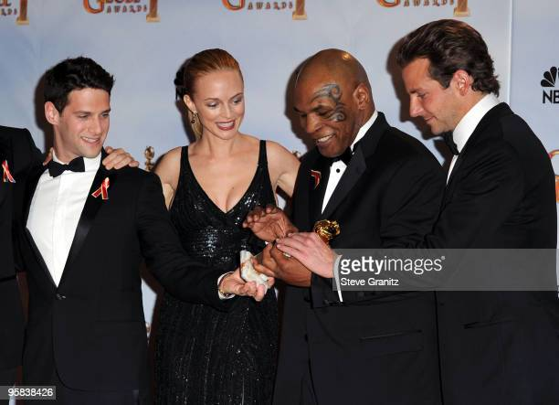Actors Justin Bartha Heather Graham Boxer Mike Tyson and actor Bradley Cooper pose in the press room at the 67th Annual Golden Globe Awards at The...