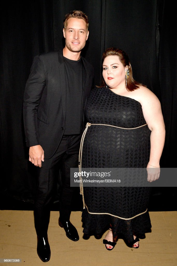 Actors Justin Hartley (L) and Chrissy Metz backstage at the 2018 Billboard Music Awards at MGM Grand Garden Arena on May 20, 2018 in Las Vegas, Nevada.
