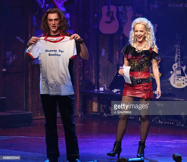 Actors Justin Matthew Sargent and actress Lauren Zakrin onstage during the curtain call for Lauren Zakrin's debut performance in the Broadway...