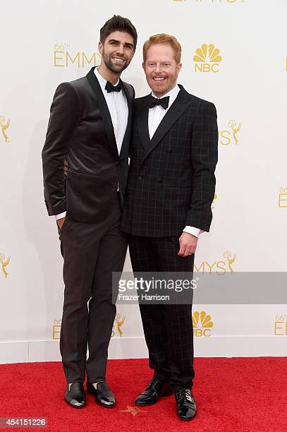 Actors Justin Mikita and Jesse Tyler Ferguson attend the 66th Annual Primetime Emmy Awards held at Nokia Theatre LA Live on August 25 2014 in Los...