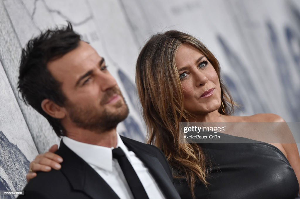 Actors Justin Theroux and Jennifer Aniston arrive at the Season 3 Premiere of 'The Leftovers' at Avalon Hollywood on April 4, 2017 in Los Angeles, California.