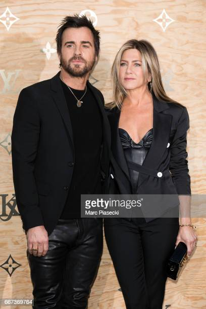 Actors Justin Theroux and Jennifer Aniston attend the 'Louis Vuitton Masters a collaboration with Jeff Koons' dinner at Musee du Louvre on April 11...