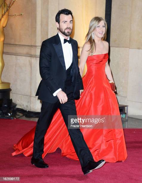 Actors Justin Theroux and Jennifer Aniston depart the Oscars at Hollywood Highland Center on February 24 2013 in Hollywood California