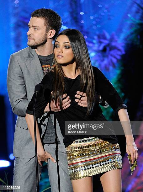 Actors Justin Timberlake and Mila Kunis speak onstage during the 2011 MTV Movie Awards at Universal Studios' Gibson Amphitheatre on June 5 2011 in...