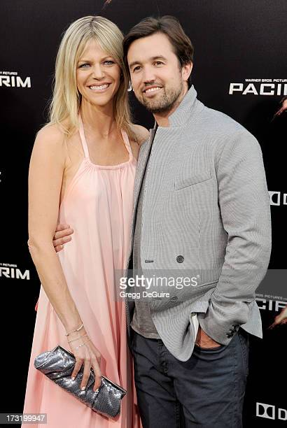 Actors Kaitlin Olson and Rob McElhenney arrive at the Los Angeles premiere of 'Pacific Rim' at Dolby Theatre on July 9 2013 in Hollywood California