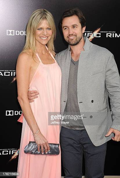 Actors Kaitlin Olson and Rob McElhenney arrive at the 'Pacific Rim' Los Angeles Premiere at Dolby Theatre on July 9 2013 in Hollywood California