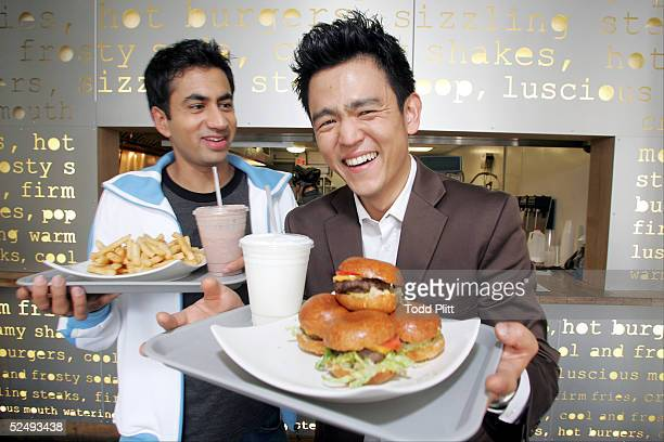 Actors Kal Penn and John Cho poses for a portrait while promoting their movie 'Harold and Kumar Go To White Castle' at Pop's Burger in downtown New...