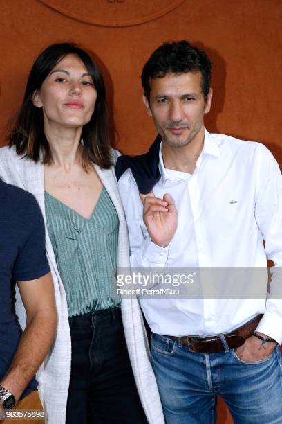 Actors Kamel Belghazi and his wife Marine Thierry attend the 2018 French Open Day Three at Roland Garros on May 29 2018 in Paris France