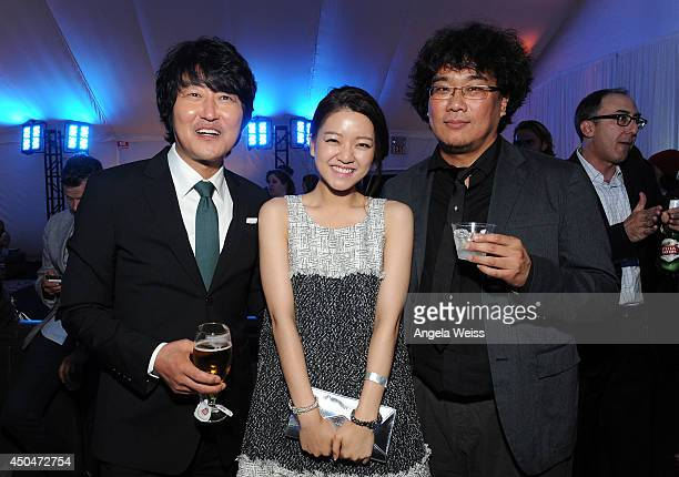 Actors Kangho Song Ahsung Ko and director Joonho Bong attend the after party for the opening night premiere of 'Snowpiercer' during the 2014 Los...