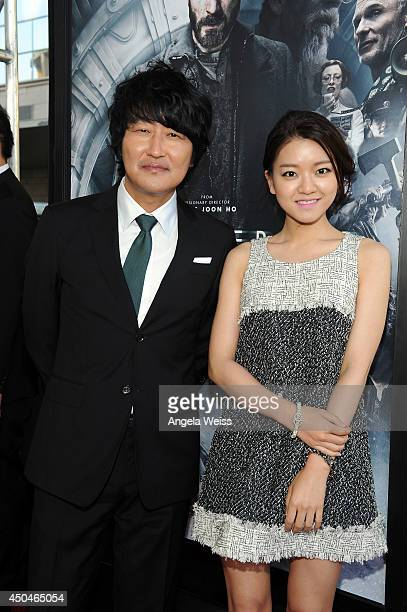 Actors Kangho Song and Ahsung Ko attend the opening night premiere of 'Snowpiercer' during the 2014 Los Angeles Film Festival at Regal Cinemas LA...