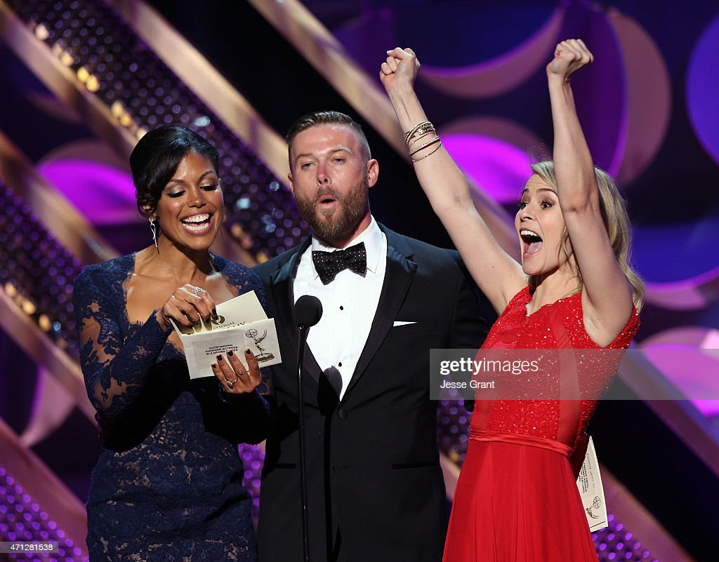Actors Karla Mosley, Jacob Young, and Linsey Godfrey onstage during The 42nd Annual Daytime Emmy Awards at Warner Bros. Studios on April 26, 2015 in Burbank, California.