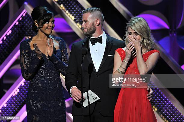 Actors Karla Mosley Jacob Young and Linsey Godfrey speak onstage during the 42nd Annual Daytime Emmy Awards at Warner Bros Studios on April 26 2015...