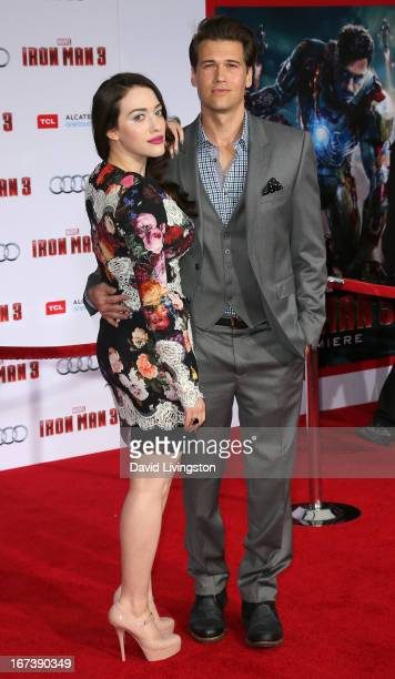 Actors Kat Dennings and Nick Zano attend the premiere of Walt Disney Pictures' Iron Man 3 at the El Capitan Theatre on April 24 2013 in Hollywood...