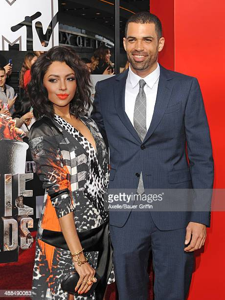 Actors Kat Graham and Cottrell Guidry arrive at the 2014 MTV Movie Awards at Nokia Theatre LA Live on April 13 2014 in Los Angeles California