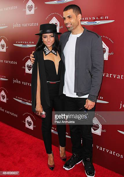 Actors Kat Graham and Cottrell Guidry attend the 11th annual Stuart House Benefit at John Varvatos on April 13 2014 in Los Angeles California