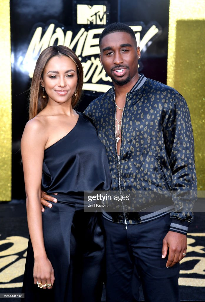 Actors Kat Graham (L) and Demetrius Shipp Jr. attend the 2017 MTV Movie And TV Awards at The Shrine Auditorium on May 7, 2017 in Los Angeles, California.