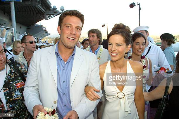 Actors Kate Beckinsale right and Ben Affleck arrive at the premiere of the film Pearl Harbor aboard the aircraft carrier USS John C Stennis May 21...