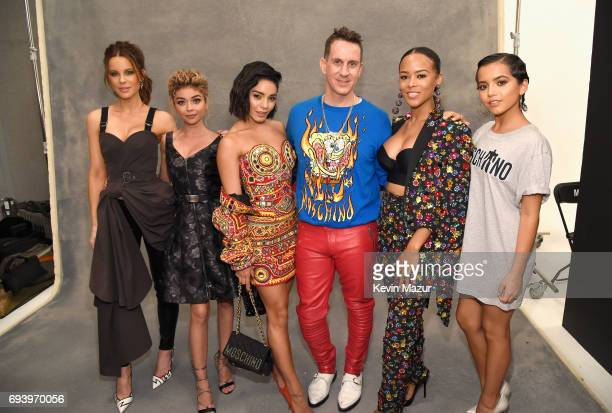 Actors Kate Beckinsale Sarah Hyland Vanessa Hudgens designer Jeremy Scott and actors Serayah McNeill and Isabela Moner pose backstage at Moschino...
