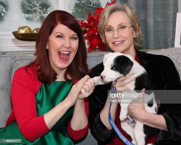 """Actors Kate Flannery and Jane Lynch poses with a rescue dog on the set of Hallmark Channel's """"Home & Family"""" at Universal Studios Hollywood on..."""