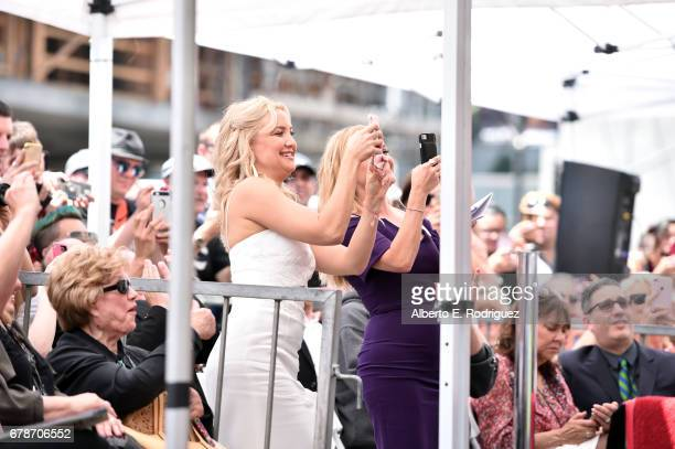 Actors Kate Hudson and Reese Witherspoon take photos in the crowd as Kurt Russell and Goldie Hawn are honored with a double star ceremony on the...