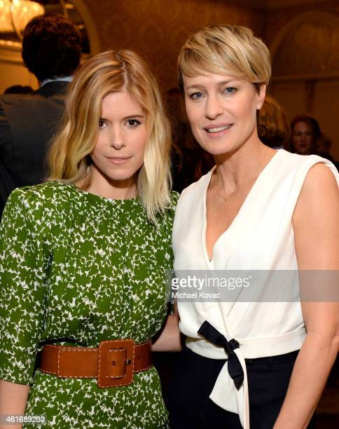 Actors Kate Mara and Robin Wright attend the 14th annual AFI Awards Luncheon at the Four Seasons Hotel Beverly Hills on January 10 2014 in Beverly...