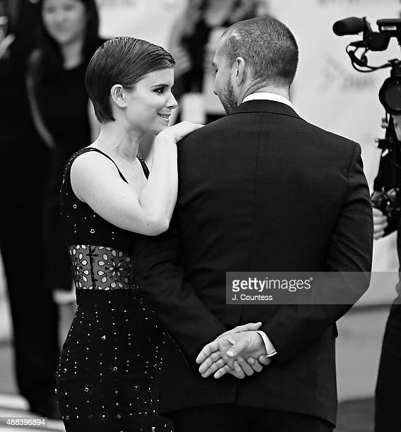 Actors Kate Mara and Shia LaBeouf pose for photos at the 'Man Down' premiere during the 2015 Toronto International Film Festival at Roy Thomson Hall...