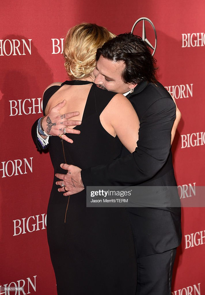 Actors Kate Winslet (L) and Johnny Depp attend the 27th Annual Palm Springs International Film Festival Awards Gala at Palm Springs Convention Center on January 2, 2016 in Palm Springs, California.