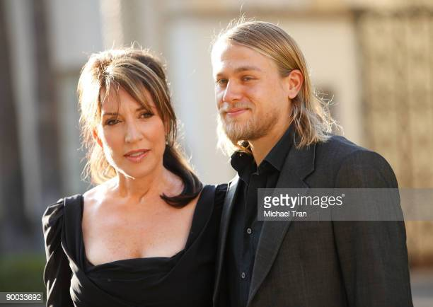 Actors Katey Sagal and Charlie Hunnam arrive to the Sons of Anarchy Season 2 premiere screening held at the Paramount Theater on the Paramount...