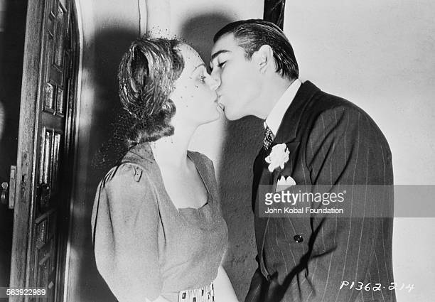 Actors Katherine DeMille and Anthony Quinn kissing on their wedding day for Paramount Pictures 1937