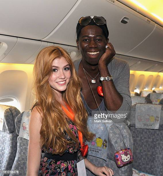 Actors Katherine McNamara and J Alexander onboard the EVA Boeing 777300ER Hello Kitty Jet at LAX Airport on September 18 2013 in Los Angeles...