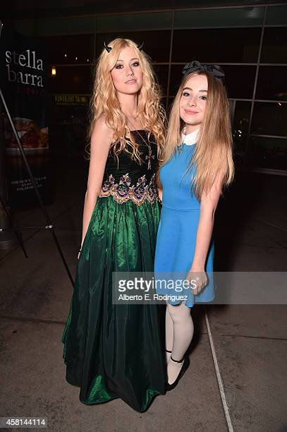 Actors Katherine McNamara and Sabrina Carpenter arrive for the Los Angeles premiere of RADiUSTWC's Horns at ArcLight Hollywood on October 30 2014 in...