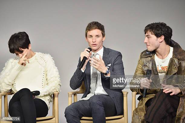 Actors Katherine Waterston Eddie Redmayne and Ezra Miller attend the Apple Store Soho presentation of Meet the Cast 'Fantastic Beasts And Where To...