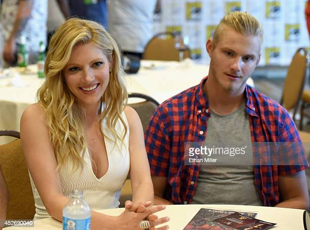 Actors Katheryn Winnick and Alexander Ludwig attend a media room for the History series 'Vikings' during ComicCon 2014 at the Hilton San Diego...