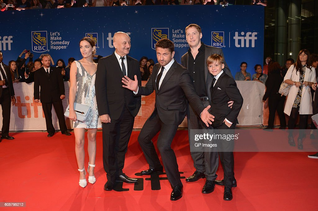 Actors Kathleen Munroe, Anupam Kher, Gerald Butler, director Mark Williams and actor Maxwell Jenkins attend 'The Headhunter's Calling' premiere during 2016 Toronto International Film Festival at Roy Thomson Hall on September 14, 2016 in Toronto, Canada.