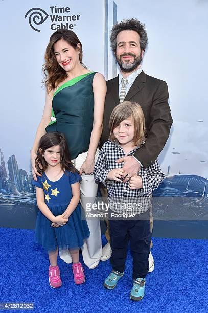 Actors Kathryn Hahn and Ethan Sandler with Mae Sandler and children Leonard Sandler attend the world premiere of Disney's Tomorrowland at Disneyland...