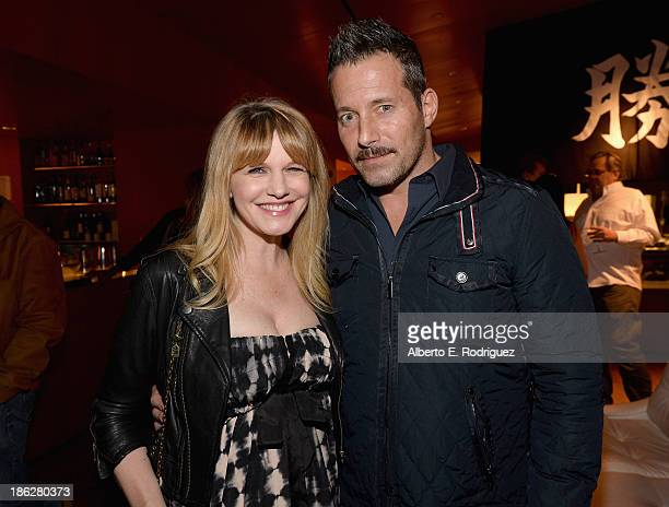 Actors Kathryn Morris and Johnny Messner attend the launch party for legendary producer Jerry Bruckheimer's book Jerry Bruckheimer When Lightning...