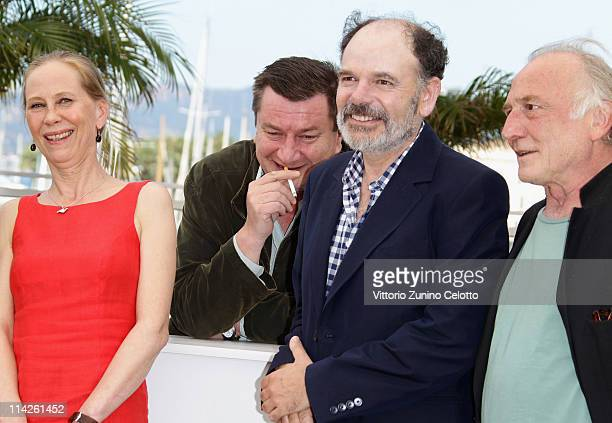 Actors Kati Outinen director Aki Kaurismaki JeanPierre Darroussin and Blondin Miguel attend the 'Le Havre' photocall at the Palais des Festivals...