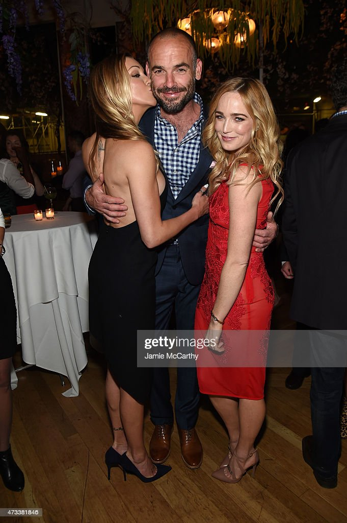 Actors Katie Cassidy, Paul Blackthorne and Caity Lotz attend the CW Network's 2015 Upfront party at Park Avenue Spring on May 14, 2015 in New York City.