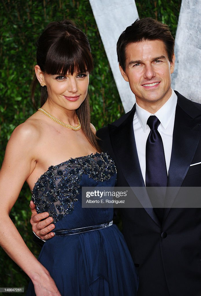 Actors Katie Holmes and Tom Cruise arrive at the 2012 Vanity Fair Oscar Party hosted by Graydon Carter at Sunset Tower on February 26, 2012 in West Hollywood, California.