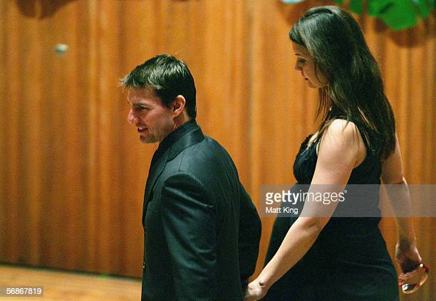 Actors Katie Holmes and Tom Cruise attend the memorial service for Kerry Packer at the Sydney Opera House on February 17 2006 in Sydney Australia...
