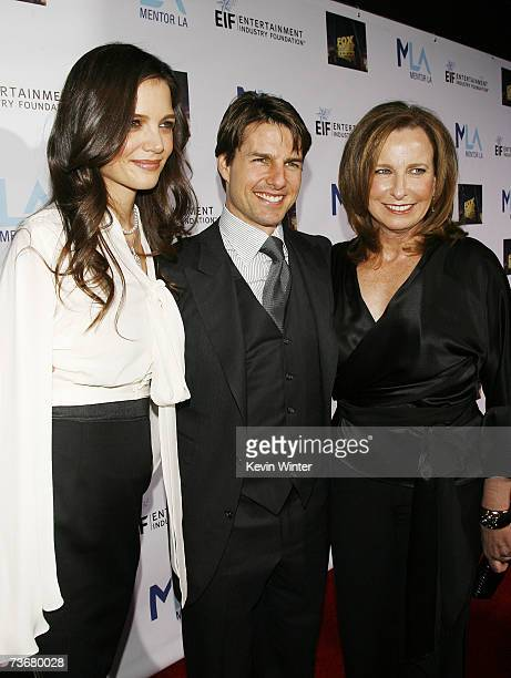 Actors Katie Holmes and Tom Cruise pose with event chair Megan Chernin at MENTOR LA's Promise Gala honoring Tom Cruise at Twentieth Century Fox...