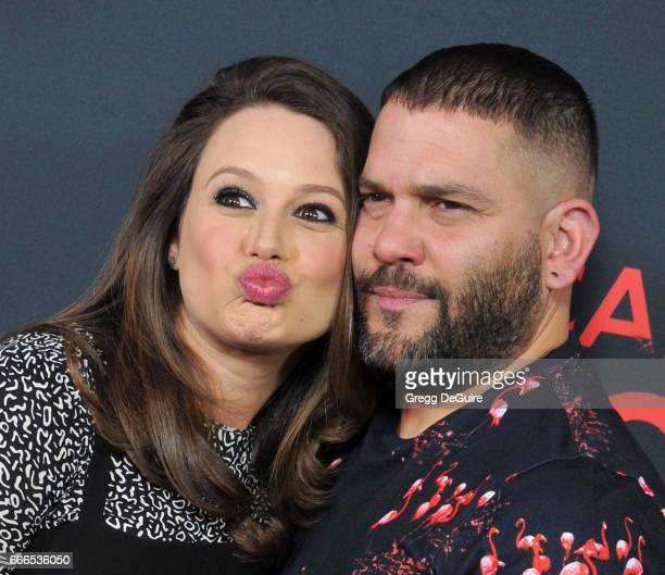 Actors Katie Lowes and Guillermo Diaz arrive at ABC's Scandal 100th Episode Celebration at Fig Olive on April 8 2017 in West Hollywood California