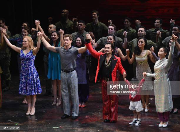 Actors Katie Rose Clarke Alistair Brammer Jon Jon Briones Jace Chen and Eva Noblezada take part in the curtain call on the opening night of Miss...