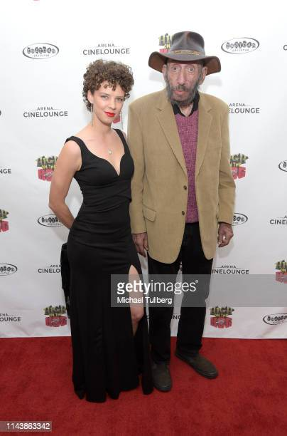 """Actors Katrina Wolf Hill and Sid Haig attend a screening of Indican Pictures' """"High On The Hog"""" at Arena Cinelounge on April 19, 2019 in Hollywood,..."""