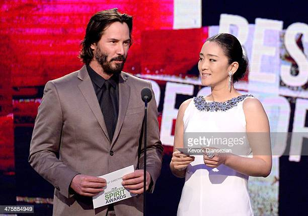 Actors Keanu Reeves and Gong Li speak onstage during the 2014 Film Independent Spirit Awards at Santa Monica Beach on March 1 2014 in Santa Monica...