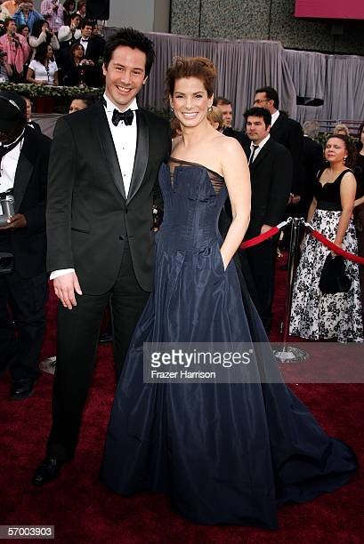 Actors Keanu Reeves and Sandra Bullock arrive at the 78th Annual Academy Awards at the Kodak Theatre on March 5, 2006 in Hollywood, California.